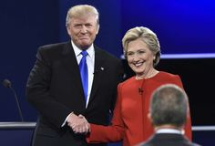 Democratic nominee Hillary Clinton shakes hands with Republican nominee Donald Trump during the first presidential debate.