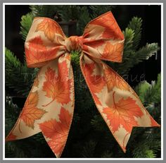 Orange wire edged bow 'Maple' http://stores.ebay.co.uk/Typically-Unique-Flowers-and-Gifts?_rdc=1