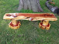 "Beautiful Eastern Red Cedar Bench made with a custom cut 3"" thick top, log legs, and crosscut cedar slabs."