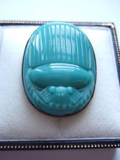 Egyptian Revival turquoise glass scarab brooch by Inglenookery. View 1.