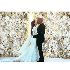 Kim Kardashian stunned in a custom-made Givenchy haute couture gown designed by Riccardo Tisci she tied the knot with Kanye West at the Forte Di Belvedere in Florence, Italy, in front of a 200-person crowd of close family and friends.