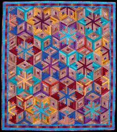 "Spinning Stars. 64"" X 72"" Diamond Log Cabin Machine pieced, handquilted Cottons ©2010 Flavin Glover"