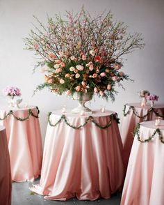 A lot of winter weddings incorporate bare branches, but why not try blossoming ones that hint at the coming spring?