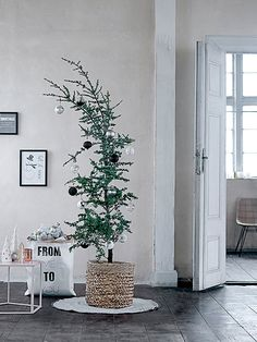 Be bold and choose a different type of tree. Keep the ornaments in neutral colors and you've got a Nordic Christmas styling!