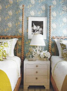 Guest bedroom with twin beds and flowered blue wallpaper