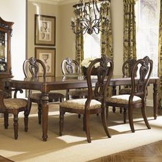 Wood dining table with fluted legs and raised acanthus leaf details. Comes with 2 extendable leaves.       Product: Dining table...