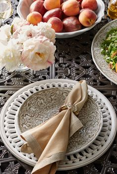 The tray and plates in our Embossed Floral and Victorian Collection are clad with an ornate floret medallion design in taupe.