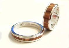 Olive wood and sterling silver weding rings    This rings are made from a sterling silver band and a pieces of olive wood, which has been cut