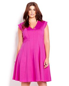 Make a fashion statement in this bright dress! Features V-neckline, flattering vertical panels that elongate the silhouette and zipper closure at back. 40 inch length. Be ready to turn heads!