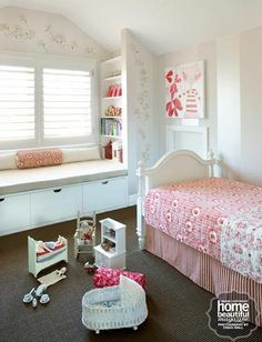 put bookcases sidesways on either side of window - one on it's side under window with cushion on top for reading area....