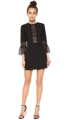A topknot balances the sweet silhouette of this Self Portrait Bell Sleeve Dress. Wear it with strappy sandals and delicate studs.