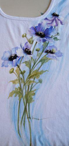 Pintura semi aquarelada, miolos bordados com miçangas.