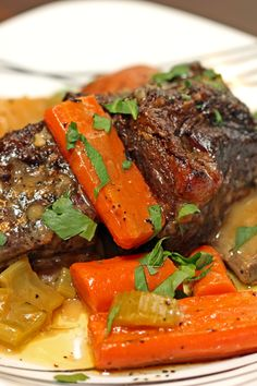Not in your typical tomato based, red wine sauce Braised Beef Short Ribs, but in a white wine and herbed sauce that starts with a mirepoix and red potatoes.