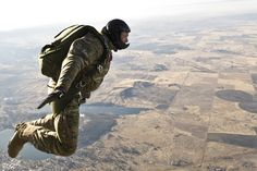 U.S. Air Force Staff Sgt. Sean Marlow, a survival, evasion, resistance and escape (SERE) specialist, performs a free-fall parachute jump from a UH-1N Iroquois helicopter above Fairchild Air Force Base, Wash., Dec. 5, 2011.  Both static line and free-fall training courses are mandatory to become a SERE specialist. (U.S. Air Force photo by Airman 1st Class Taylor Curry)