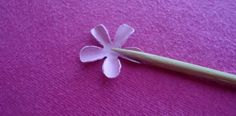 Curl the petals around the skewer.