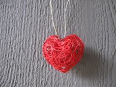 DIY heart necklace. Made with embroidery floss.