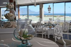 Positioned perfectly with unrivalled views of Table Mountain and Table Bay, Blowfish Restaurant is one of Cape Town's finest seafood and sushi restaurants. Windows spanning the length of the restaurant allow guests to enjoy the magnificent views, fresh ocean breeze and sound of the Atlantic Ocean. Sushi Restaurants, Table Mountain, Beautiful Wedding Venues, Windsurfing, Atlantic Ocean, Beach Hotels, Cape Town, Interior And Exterior, Breeze