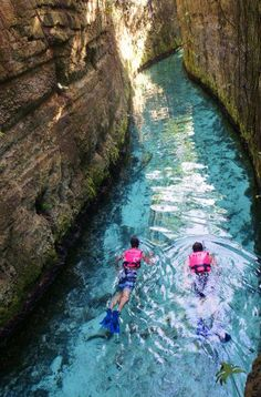 Swimming in Xcaret underground rivers. Riviera Maya, Mexico.