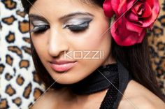 gorgeous woman wearing a rose in her hair. - Close-up of a gorgeous Indian female fashion model wearing a rose in her hair, Model: Stephanie Reddy