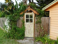 Don't get rid of that old scuffed-up wooden door. Let it age gracefully outdoors while serving as a connection between the past and present in the form of a rustic garden gate.