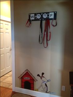 Spray paint a wood cost hanger with the dogs rooms colors and hang leashes and collars and vests