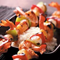 Tangy Shrimp Kabobs Recipe - I love shrimp - pretty much any way it is cooked, so this recipe is right up my alley. Except I live in beautiful South Dakota where a pound of shrimp costs more than ribeye steak. So, one of ya'll make this dish and then pin how good it is - I will enjoy it vicariously through you.