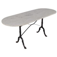 Oval French Bistro Table This Bistro Table has the perfect size. Long enough for 8 guests and plenty of leg room. Found in the Bresse Region, this early 1900's Bistro Table has a cast iron base signed SNES and a beautiful Carrara white marble top.