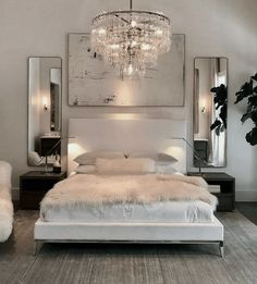 Luxury All White Bedroom Decor Luxury bedroom with white bed, white walls, chrome assents, crystal chandaleer, and sheepskin blanket White Bedroom Decor, Cozy Bedroom, Home Decor Bedroom, Bedroom Modern, Ikea Bedroom, Bedroom Brown, Budget Bedroom, Scandinavian Bedroom, Stylish Bedroom