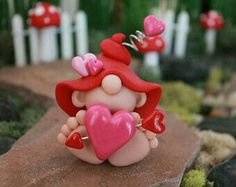 Items similar to Polymer Clay Valentine Baby Gnome - Miniature Baby Gnome - Mini Clay Baby Gnome - Fairy Garden Accessory - Baby Gnome Sculpture on Etsy Polymer Clay Figures, Fimo Clay, Polymer Clay Projects, Polymer Clay Creations, Polymer Clay Crafts, Handmade Polymer Clay, Diy Cadeau Noel, Fairy Garden Accessories, Baby Accessories