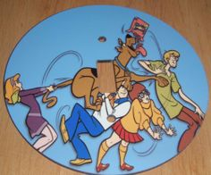 SCOOBY DOO Light switch Cover 5 Inch Round (12.5 cms) Switch plate Switchplate by Character Creations. $12.00. Hardboard with Beautiful Glossy Finish. Beautifully finishes off any room. Large 5 inches (12.5 cms) Lightswitch Cover. Scooby Doo Design. NOT a Sticker.  Image is heat sealed into the switchplate, therefore is completely washable.. This is a fantastic addition to any bedroom or playroom and is made from hardboard, with a glossy front.  This item is made from ...
