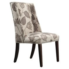 Equally at home in your foyer or pulled up to the dining table, this wingback side chair showcases classic nailhead trim and botanical-print upholstery....