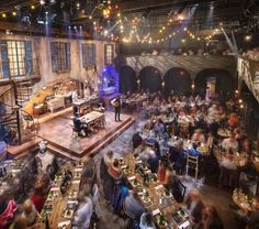 Lookingglass Theatre Company image - I like the layout around the stage - long tables?
