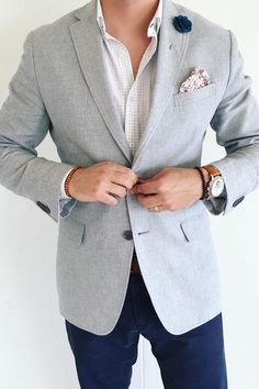 Ryne Hammons is tailored and sharp in our men's light gray wool suit jacket, which he styles over a white and gray plaid button down and navy pants | Banana Republic