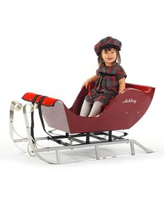 This sleigh is made for trips over the hills and through the woods thanks to a high-quality steel hull that glides easily over snow and a padded bench seat that keeps kids comfy. The personalized, antique-style design is sure to inspire cheer in any little darling.Personalize name up to nine characters46'' W x 19'' H x 18'' D