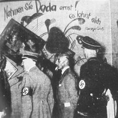 Hitler in front of a Dada poster! - art opening in Munich, 1937