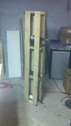 Wine shelf from pallet. But this up against the outside cabinet for a built in look