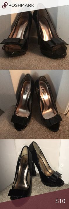 Black Charolette Russe Heels Lightly used (tread is somewhat worn and seam on one shoe is tearing and showing slight discoloration) 4 and 1/2 inch heel 1/2 inch platform Open-toe Bow-thing overlapping toes Thicker heel No size on shoe but fit like a 6.5 Charlotte Russe Shoes Heels