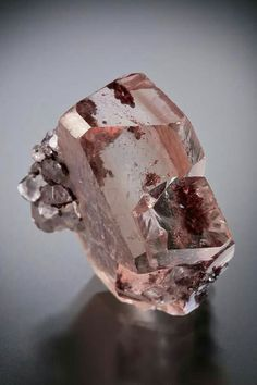 Twinned Dolomite with hematite inclusions