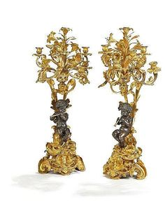 A pair of large Napoleon III gilt and patinated bronze seven