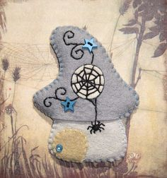 Cabaña de brujas tela de araña, via Flickr.