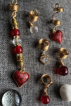 DBC Red Glitter Heart Charm Loc and Braid Jewelry Set This 6 piece loc and braid jewelry set includes a 3 inch focal piece with a Glitter finish charm and 5 accent cuffs. Dread Accessories, Natural Hair Accessories, Natural Hair Styles, Diy Hair Jewellery, Dreadlock Jewelry, Dread Jewelry, 70s Hair, Diy Hairstyles, Dreadlock Hairstyles