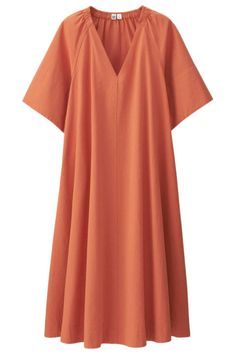 Throw on this orange Uniqlo U Seersucker Short Sleeve Dress for a quick and casual summer look.