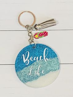 Circle shaped acrylic, glitter and epoxy keychain with tassel and charm. Because these are handmade items there may be slight differences. How To Make Keychains, Diy Resin Keychain, Cool Keychains, Handmade Keychains, Acrylic Keychains, Leather Keychain, Keychain Ideas, Handmade Items, Diy Resin Crafts
