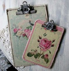 Old floral cards and papers glued over fabric on clip boards, rose on clip