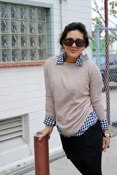 patterned utility shirt + pullover sweater + black skinnies + heels or booties