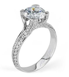 From Michael M. Collection Diamond pave decorates strings of diamonds that arch to cradle a 2.00 carat diamond centerstone.
