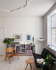 Book shelves in An Elegant Danish Family Home in The Heart of Copenhagen