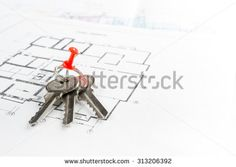 Model house, construction plan for house building, keys, divider compass and clipboard. Real Estate Concept. Top view.