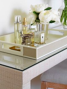 Ikea Malm dressing table hack -- covered with raffia textured wallpaper and glass top