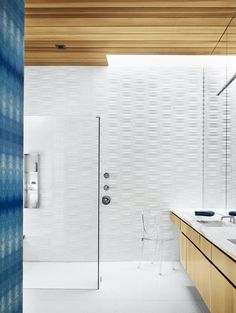 Cover Story: This House in Austin Has a Tree Growing Right Through It - Photo 7 of 10 - The bathroom is covered in Heath tile and indigo Eskayel wallpaper. The Ghost chair is by Philippe Starck.